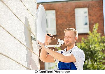 Man Installing TV Satellite Dish