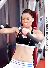 athletic woman using a bench press - Beautiful athletic...