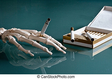 Smoking issues - Skeleton hand holding burning cigarette