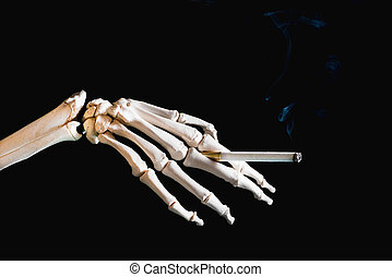 Smoking kills - skeleton hand holding a cigarette