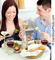 Laughing couple having dinner - Laughing caucasian couple...