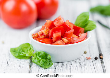 Portion of Diced Tomatoes - Diced Tomatoes on a vintage...