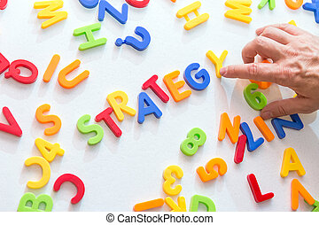 lots of colorful letters, hand building word strategy,...