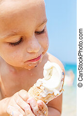Boy eating ice cream - Beautiful boy is eating an ice cream...