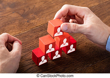 Block Of Team On Wooden Desk - Person Hand Building A Blocks...