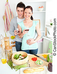 Enamored couple drinking wine in the kitchen