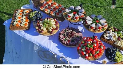 Beautifully decorated catering banquet table with different food snacks and appetizers on corporate christmas birthday party event or wedding celebration