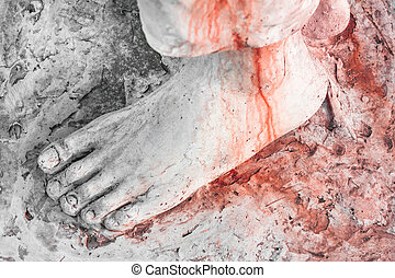Foot of Christ bloodied - Extreme close-up of the feet of...