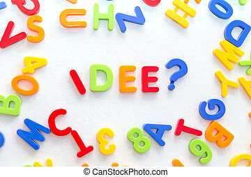 lots of colorful letters on a table, german word in the...