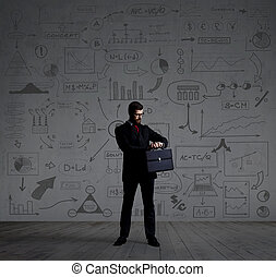 Businessman with a case on a diagram background -...