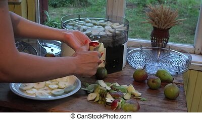 Fruit drying. Closeup. - Female grower hands peeling and...