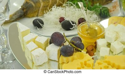 cheese on plate with grapes