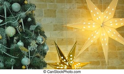 Christmas tree with toys and two stars shine in the background