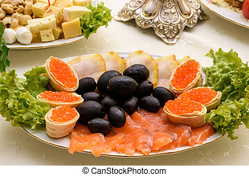 Red caviar with smoked salmon snack. Russian cuisine appetizer