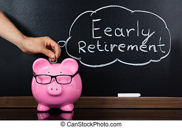 Piggybank With Retirement Concept On Blackboard