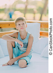 boy shorts is resting on the couch - hot sunny day in a park...