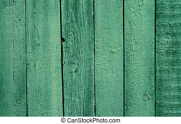 Old wooden green painted fence, beautiful background for...
