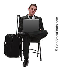 Mobile technology - Young traveler businessman working on a...