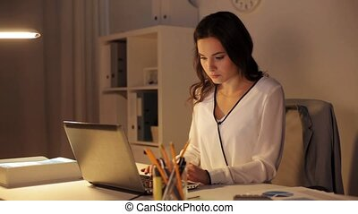 woman closing laptop and leaving night office - business,...