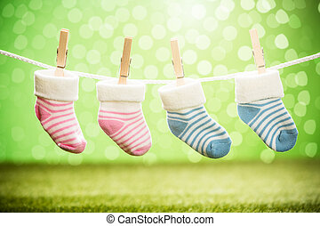 Pair Of Baby Sock Hanging On Rope