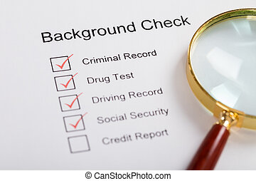 Magnifying Glass Over Background Check Form - High Angle...