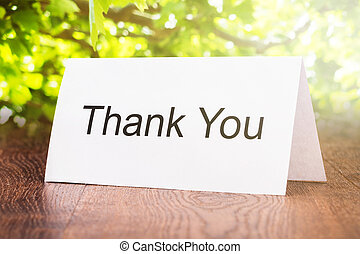 Thank You Card On Wooden Floor