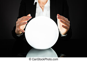 Businesswoman On Crystal Ball - Businesswoman Hands On...