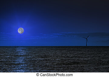 Wind turbine at night with moonlight over the sea - A...