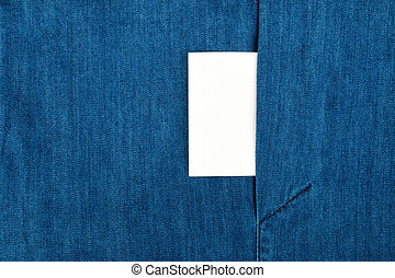Blank business card with copy space in a pocket of blue jean...