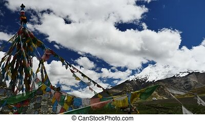 Lungta Snowcap Glacier on mountain Tibet sky and clouds -...