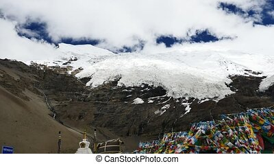 Snowcap Glacier on mountain Tibet sky and clouds - TIBET...