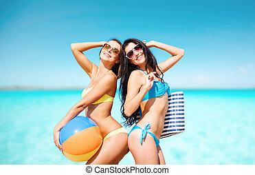 happy young women in bikini posing on summer beach - summer...