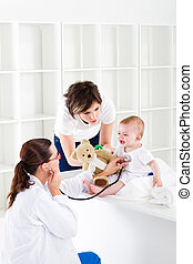 doctor office - mother and baby in pediatrician doctor...