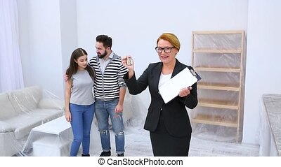 Real estate agent showing apartment or flat - Happy real...