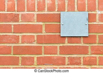 Brick wall pattern with blue metal plaque - pattern created...