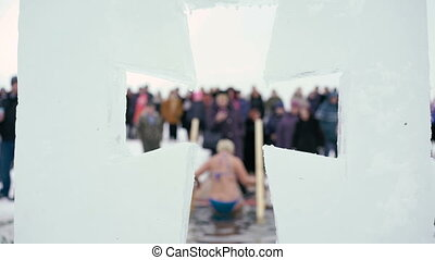 Ice cross. Epiphany - People bathe in ice water. 4k