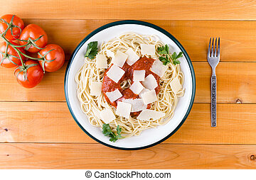 Spaghetti pasta with tomato sauce and cheese