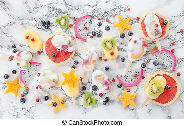 Homemade frozen popsicles and fresh exotic fruits
