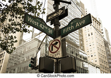 West 42nd Street, Fifth Ave, One way, No turn signs and...