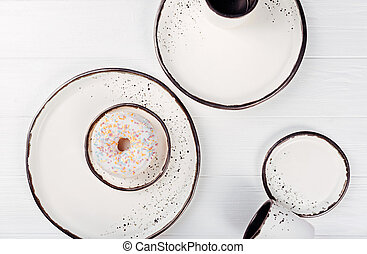 Sweet colorful doughnut lying on a table - White perfection....