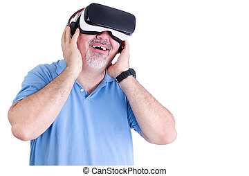 Smiling man holds virtual reality glasses to face - Smiling...