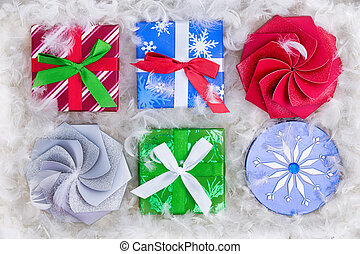 Six Christmas gift packages surrounded by feathers - Top...