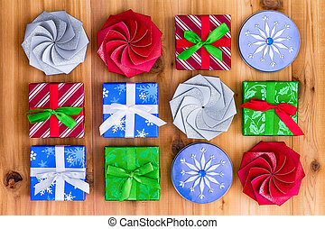 Twelve cute little Christmas gift boxes - Top down view on...