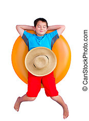Cute young boy relaxing on an inner tube - Cute barefoot...
