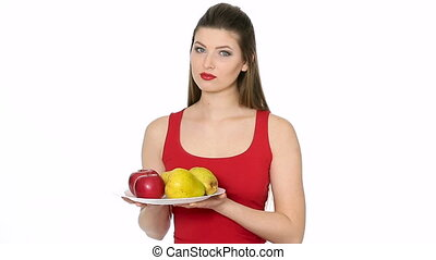 woman holding plate with red Apples and pears and smiling