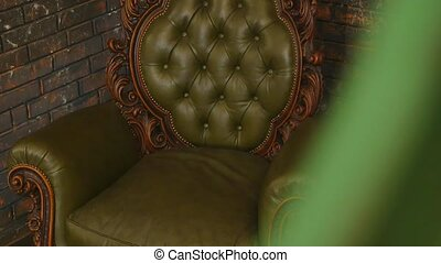 luxury green leather armchair in room.