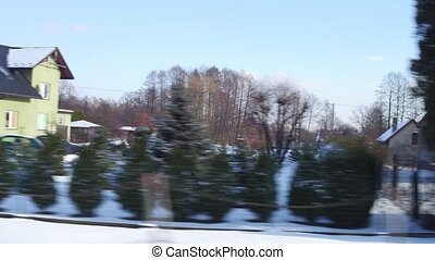 Polish outskirts winter scenery as seen from train window -...