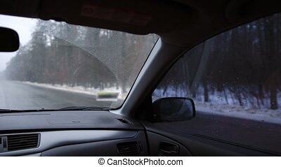 Driving car on highway in winter day