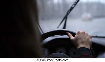 Woman holding steering wheel firmly with hand