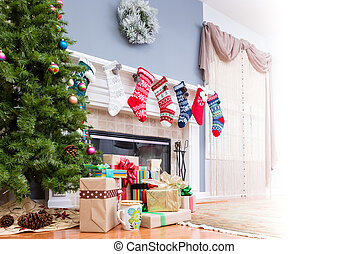 Pile of Christmas gifts under the tree with colorful...
